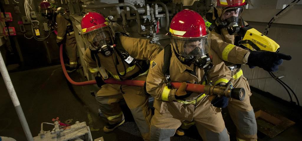 120114-N-DR144-704  ARABIAN SEA (Jan. 14, 2012) Hull Maintenance Technician 3rd Class Oscar Williams, left, Hull Maintenance Technician Fireman Matthew Colon, and Damage Controlman Fireman Donovan Jopling, lead a hose team as they combat a simulated fire in an aircraft elevator machinery room during a general quarters drill aboard the Nimitz-class aircraft carrier USS Carl Vinson (CVN 70). Carl Vinson and Carrier Air Wing (CVW) 17 are deployed to the U.S. 5th Fleet area of responsibility. (U.S. Navy photo by Mass Communication Specialist 2nd Class James R. Evans/Released)